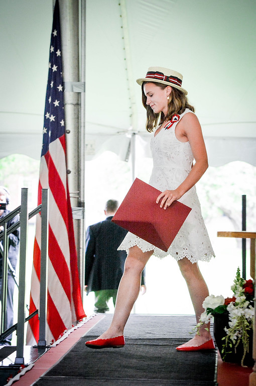 . Phoebe Fry of Groton exits the stage after receiving her diploma from Groton School. SUN/Caley McGuane