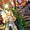 Showing off the Holiday Swag she just made is Kathy Harwood of Groton, she is at the Williams Barn where the annual Holiday Greens sale will be on Sat. SUN/ David H. Brow