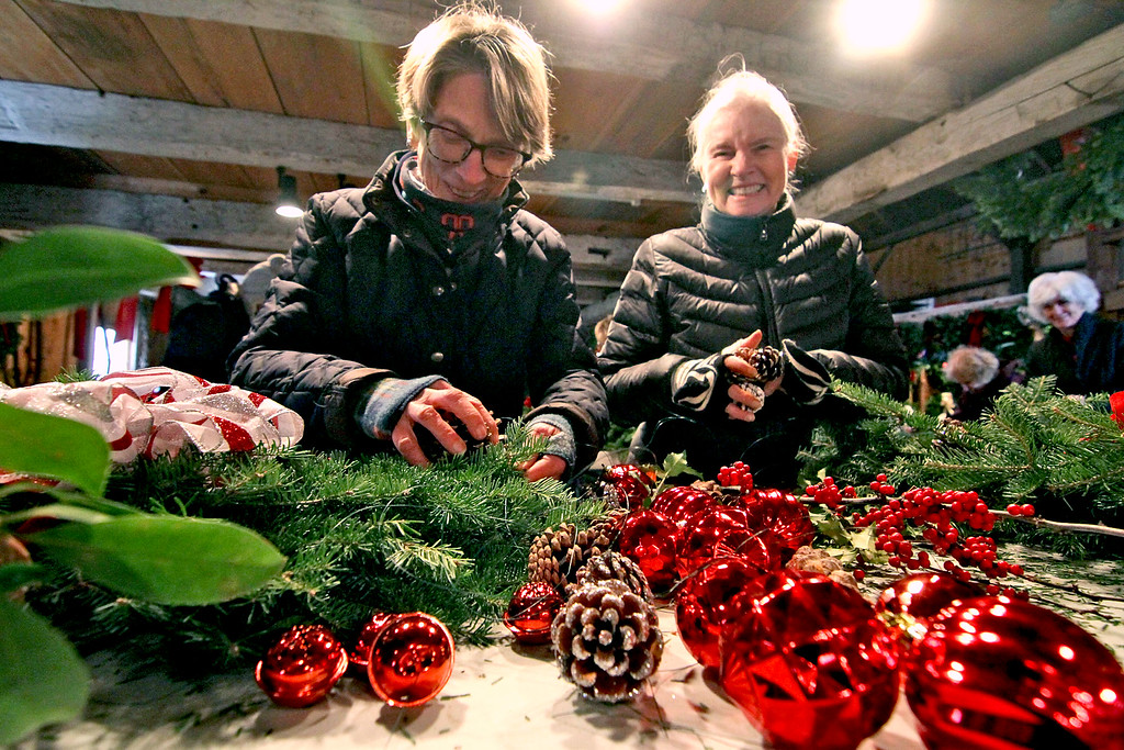 . Working on making wreaths for the Groton Women\'s Club annual greens sale are members L-R, Gail Poulter and Carly Detwiller, both of Groton. Nashoba Valley Voice/ David H. Brow