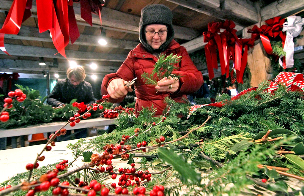 . Groton Women\'s Club member, Nancy Slaney of Groton, works hard at making holiday wreaths for the club\'s annaul greens sale. SUN/David H. Brow