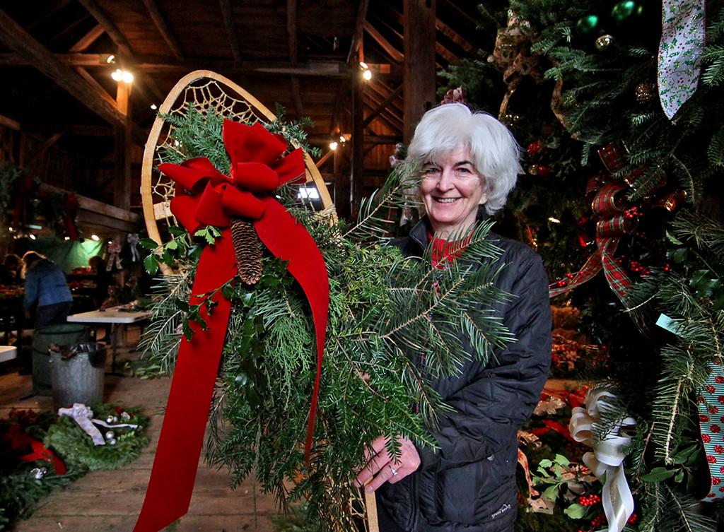 . Groton Women\'s Club member, Ann Krajewsici of Groton, holds just one of the many items up for sale at the club\'s annual Greens Sale at the William\'s Barn in Groton. SUN/David H. Brow
