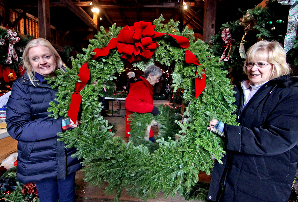 . Members of the Groton Women\'s Club haul a huge wreath as they and other members get ready for their annual Greens Sale Dec 1st at Williams Barn in Groton. SUN/David H. Brow