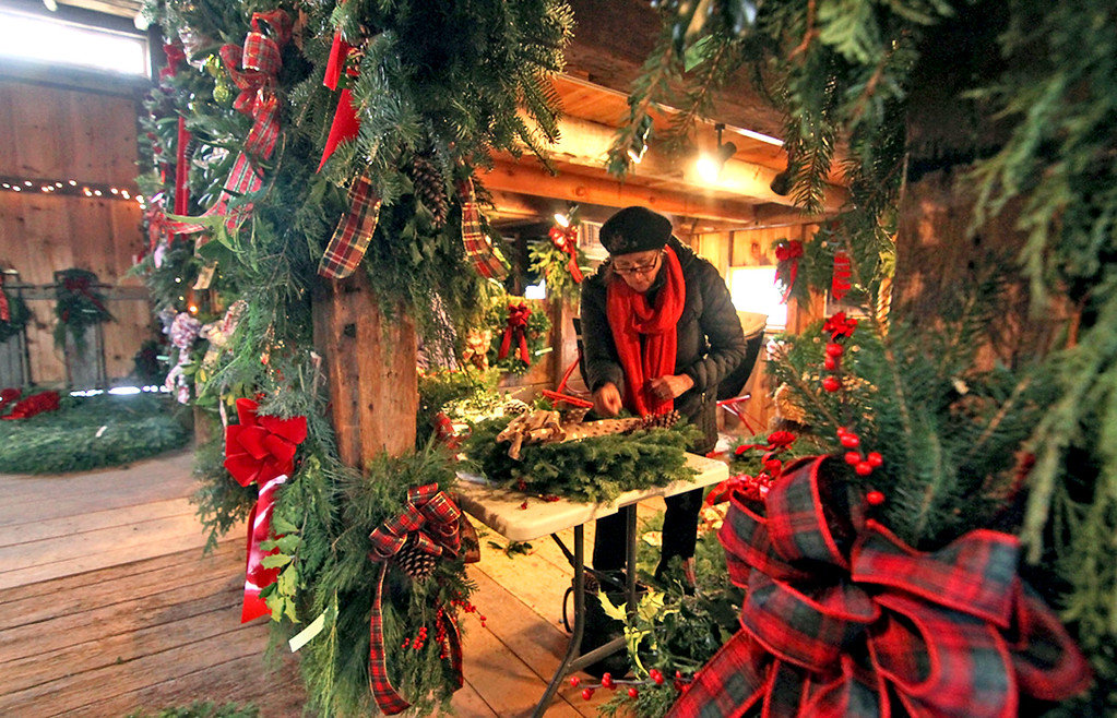 . June Cloutier of the Groton Women\'s Club, works on making wreaths for the clubs annual greens sale. Nashoba Valley Voice/ David H. Brow