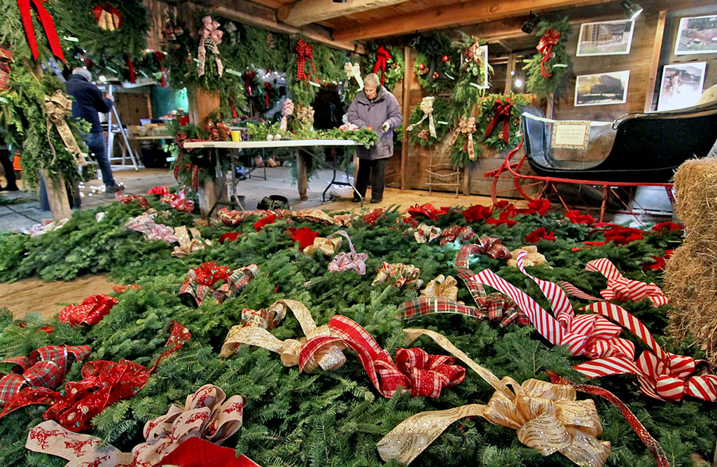 . Members of the Groton Women\'s Club making holiday wreaths, swags and other items for their annual greens sale at Williams Barn in Groton, in background is Marie King of Groton. SUN/David H. Brow