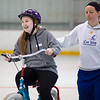 Hudson's Morghan Ghize, 15 (left) zooms away from iCan Shine director of operations Andrea Patrick on a two-wheel bicycle on April 20, 2016 at a camp that teaches kids with special needs how to ride bikes. Chris Lisinski/Nashoba Valley Voice