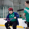 Declan Wilkins, 9, of Lowell (left) picks up speed, forcing UMass Lowell senior Hailey Tompkins to jog to catch up, at a camp to teach students with special needs how to ride a bike on April 20, 2016. Chris Lisinski/Nashoba Valley Voice