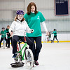 Groton's Lauren Nyilis, 13 (left), works with Emerson Hospital physical therapist Therese Whitney on a special training bicycle designed to simulate the tilt and wobble of a traditional bicycle with lower risk of falling on April 20, 2016 at a camp where children with special needs can learn how to ride bicycles. Chris Lisinski/Nashoba Valley Voice