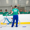 iCan Shine director of operations and lead floor supervisor Andrea Patrick gives lessons to volunteers, some of whom are students from UMass Lowell, before they begin teaching campers with special needs how to ride a bicycle on April 20, 2016. Chris Lisinski/Nashoba Valley Voice