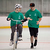 18-year-old Matthew Silvestres of Rutland (left) goes for the high-five (or is it a low-five?) with UMass Lowell senior BJ Foley during a bike camp for students with special needs at the Lawrence Academy on April 20, 2016. Chris Lisinski/Nashoba Valley Voice
