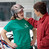 Taylor Vachris, 19, of Southborough (left) receives praise from her mother Amy Vachris after an April 20, 2016 session at a camp that teaches kids with special needs how to ride bikes. Chris Lisinski/Nashoba Valley Voice
