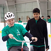 18-year-old Matthew Silvestris (left) enjoys himself alongside Westford Academy freshman Arnav Sharma at a camp to teach children with special needs how to ride a bicycle on April 20, 2016. Chris Lisinski/Nashoba Valley Voice