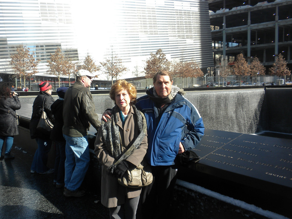 Tom and Betty standing in front of one of the two fountains at the 911 Memorial. The two Fountain represent the two Towers of the World Trade Center. The water symbolizes the people's cries which never will stop and as the water falls down inside the ground that symbolizes the emptiness left by those who died. The Fountains are also reflecting pools symbolizing peoples remembrances. The many tree planted in the adjacent courtyards are symbols of new life!