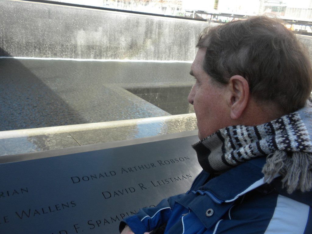 Tom and Betty visit Ground Zero, 911 Memorial.  Tom is looking at a carved list of some of the more notable victims who were killed during the attack