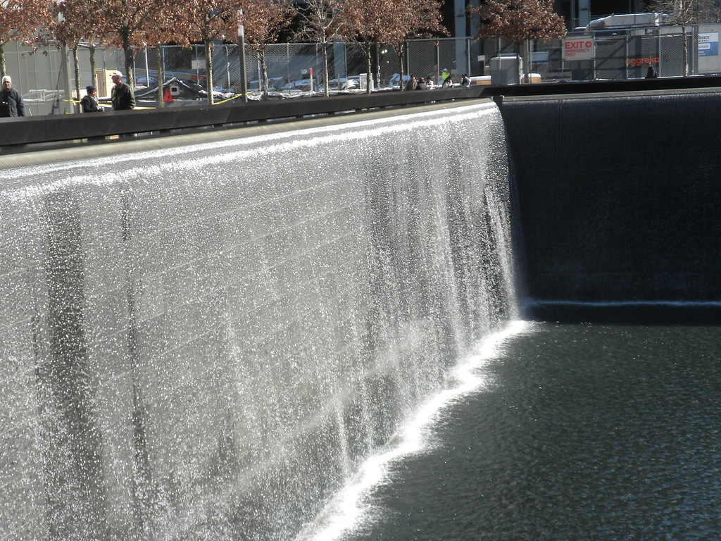 The two Fountain represent the two Towers of the World Trade Center.  The water symbolizes the people's cries which never will stop and as the water falls down inside the ground that symbolizes the emptiness left by those who died. The Fountains are also reflecting pools symbolizing peoples remembrances.  The many tree planted in the adjacent courtyards are symbols of new life!