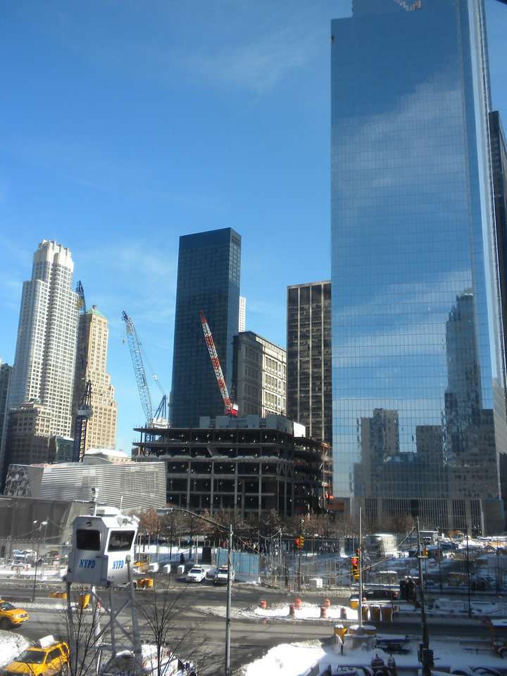 Tom and Betty visit Ground Zero, 911 Memorial in New York City.  These are the present building surrounding Ground Zero.  Taken from across the street from World Center 1, 2, 3.