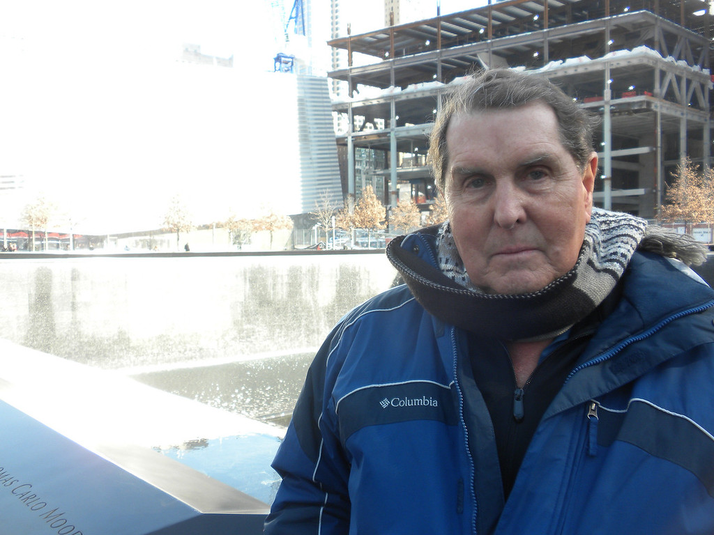 Tom standing in front of one of the two fountains at the 911 Memorial. The two Fountain represent the two Towers of the World Trade Center. The water symbolizes the people's cries which never will stop and as the water falls down inside the ground that symbolizes the emptiness left by those who died. The Fountains are also reflecting pools symbolizing peoples remembrances. The many tree planted in the adjacent courtyards are symbols of new life!