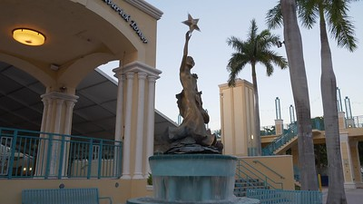 Statue woman reaching for a star Mizner Park Flossy Keesely dedicated
