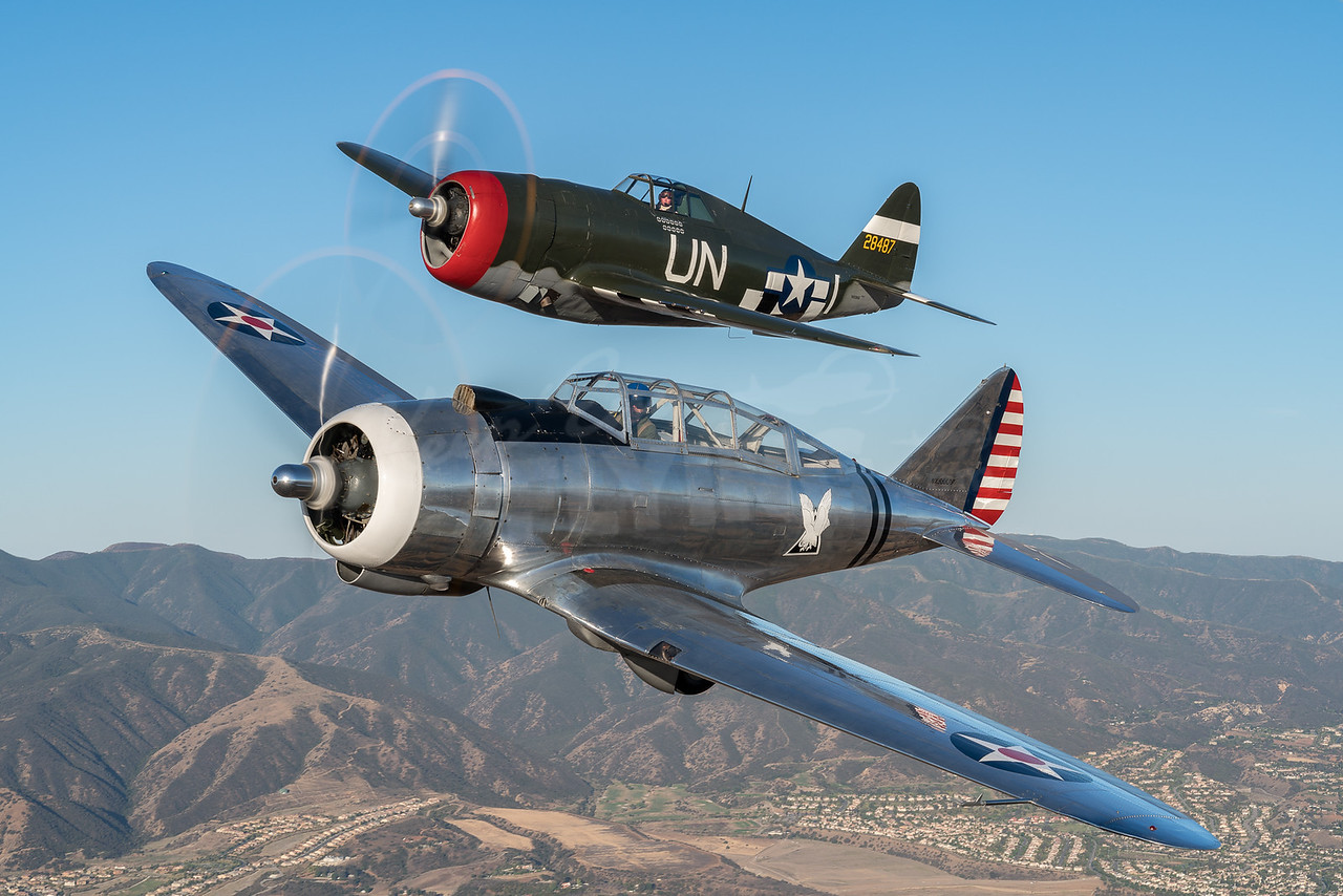 Steve Hinton Jr. in the Republic P-47G Thunderbolt and John Maloney in the world's only flying Seversky AT-12 Guardsman from Planes of Fame in Chino CA.