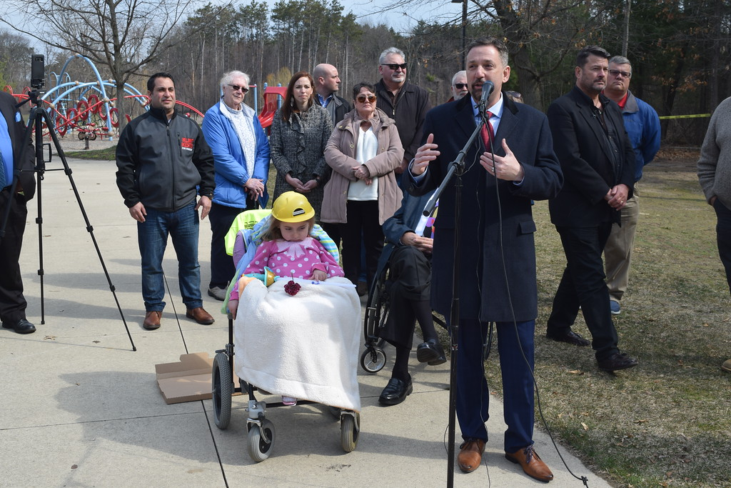 . A ceremony was held Friday, April 13, 2018, to celebrate the groundbreaking of Scarlet\'s Playground, an all-inclusive park where disabled and able-bodied children can play together. The $1 million park, which will be located at Dodge Park, 180 E. Commerce Road, will be named after Scarlet Clark, 5, who suffers from Spinal Muscular Atrophy. She is the granddaughter of Stephen and Larenne Clark of Commerce Township. (Mark Cavitt/The Oakland Press)