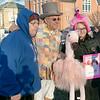 Groundhog Day with Featherstone was held on the common in Monument Square in Leominster on Friday, Jan. 31, 2020. During the event two Featherstone flamingo's saw their shadows signifying an early spring for the North Central MA region. Mayor Dean Mazzarella, center all decked out for the event, poses for a picture with Ron Girouard and Kim Fenwick while holding a stuffed flamingo he got from a local that just dropped it off at his office one day. SENTINEL & ENTERPRISE/JOHN LOVE