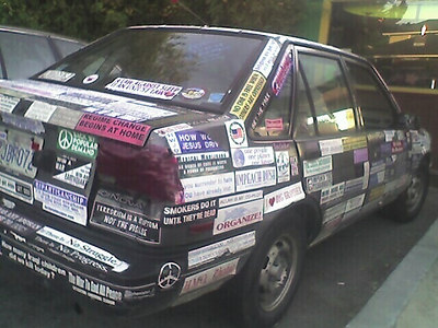 stickered car expresses self-identity of the owner in a different way from a car with no sticker on it