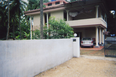 his family's house back home in southern india. it was the first time he had visited in two years. he took like, three pictures of pretty much the same view.