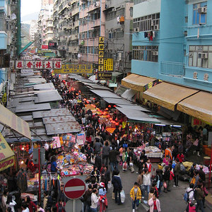 temporary street market: tranform the a road for car, to human use. kenneth