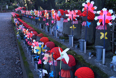 Jizo the protector of souls of stillborn children.   people constantly changing their looks. kenneth
