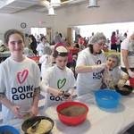 Making soup kits at Gesher -- photo by Caring Kids Cards