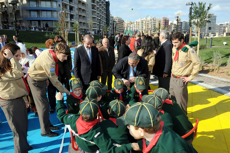 Photo: DOI - Minister George Pullicino helps the Cubs to keep going round and round!
