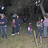 Cubs show their parents around campsite before campfire starts