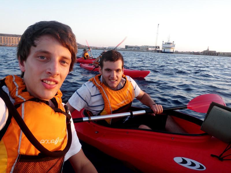 Pack leaders kayak to Comino