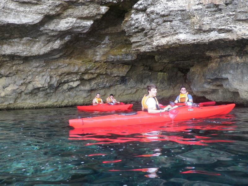 leaders explore the caves around Comino..