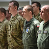 Royal Air Force and Polish Air Force airmen stand during the handover ceremony of the Baltic Air Policing mission at the Air Base of the Lithaunian Air Force in Siauliai, Lithuania April 30, 2014.