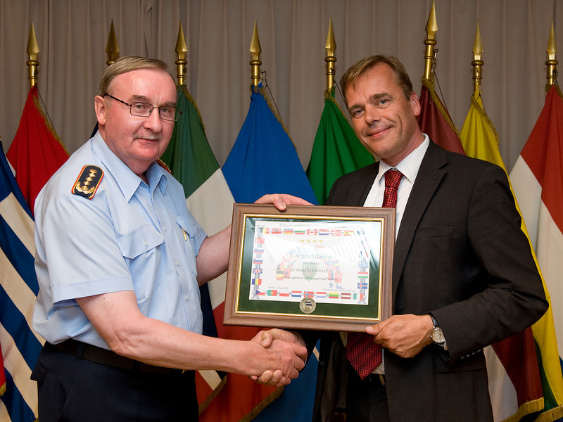 Presentation of a Chief of Staff Commendation for Exceptional Service to Ambassador Michel Rentenaar, Netherlands civilian (right), by Chief of Staff (COS) Supreme Headquarters Allied Powers Europe (SHAPE), General Manfred Lange DEU AF (left). (Photographer: SSgt Ian Houlding GBR Army)