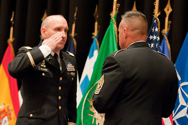 CSM Michael Balch (right) recieves the US flag from COL Jorge Silveira (left) as a traditional part of his retirement ceremony. CSM Balch relinquished responsibility as Senior Enlisted Leader to the Allied Command Operations in a ceremony on SHAPE, June 10, 2011. Photos by SGT Intisar Sabree US Army