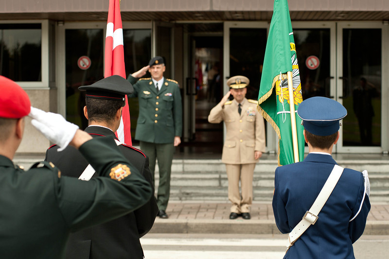 Danish Chief of Defense, Gen. Peter Bartram (left), and Adm. James Stavridis, Supreme Allied Commander Europe, salute the Danish flag during an honor guard ceremony to welcome Bartram to NATO Supreme Headquarters Allied Powers Europe, Aug. 30. (NATO photo by U.S. Army Sgt. 1st Class Seth Laughter)