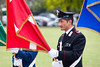 A NATO Service Member holds the Danish National Flag during a honor guard ceremony to welcome Danish Chief of Defense, Gen. Peter Bartram, Aug. 30. (NATO photo by U.S. Army Sgt. 1st Class Seth Laughter)
