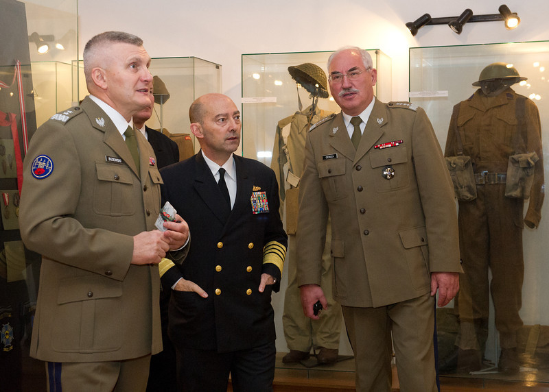 Adm. James Stavridis, Supreme Allied commander Europe is given a tour of the historic uniform display by Gen. Mieczyslaw Cieniuch, Polish Chief of Defence and Maj. Gen. Jerzy Biziewski Garrison commander at the headquarters of the Polish Chief of Defence in Krakow, Poland Nov 7, 2012. (NATO photo by U.S. Army Sgt. 1st Class VeShannah J. Lovelace)