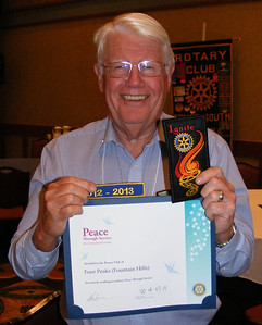 "Our club received the ""Peace Through Service Award""; the ""Ignite"" club membership growth award; and the ""District Acheivement Award"", meeting all of the goals set by our District Governor."