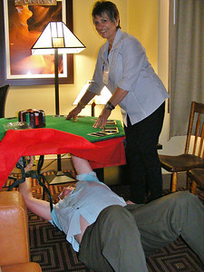 Roger and Dena set up the poker table