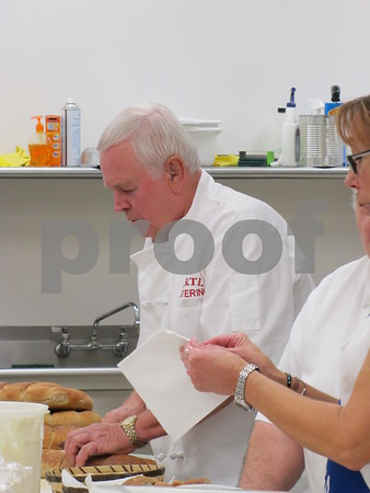 Jim Ertl busy at work in the kitchen preparing the meal for the Czech Heritage Dinner held at the Corpus Christi Parish Center.