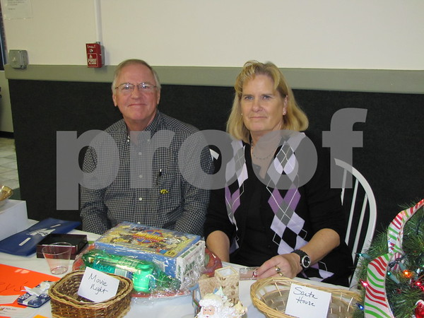Mark and Pat Essing sold raffle tickets for items at the Czech Heritage Dinner.