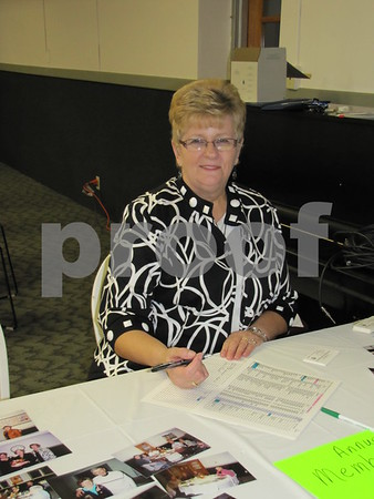 Delores Busse greeted attendees to the 33rd Annual Czech Heritage Dinner held at the Corpus Christi Parish Center.