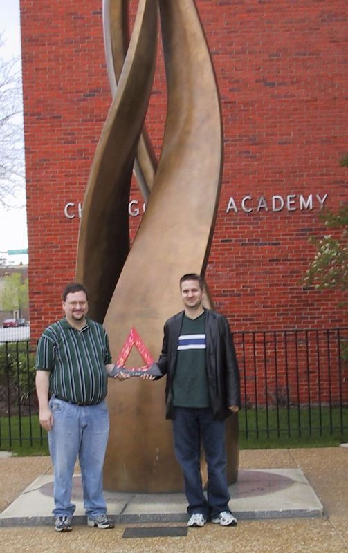 Fire at the site of the origin of the Great Chicago Fire of 1871 [4/25/2004] <p> Chuck Carroll, Z '90, and Dave Carroll, BN '95, with Fire.