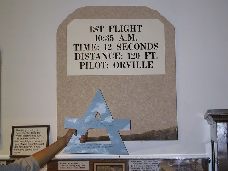 Air at Wilbur Wright birthplace [3/27/2004] <p> The Wrights made four flights (two each) in their plane on December 17, 1903.  Markers at the museum commemorate all four flights; here is Air with the first.