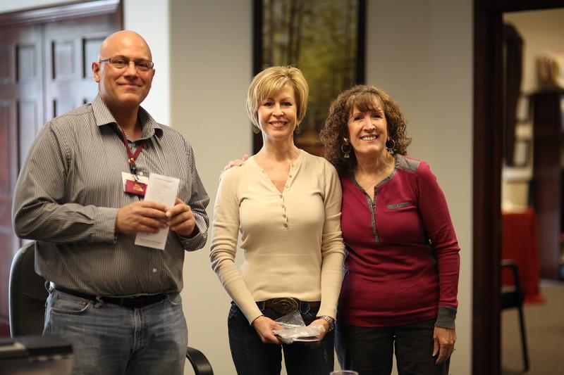 President Carl Tymann, new inductee Deb de Lancey, VP Shirley Clark.