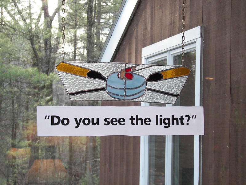 """"""" Do you see the light""""  below stained glass in window"""