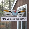 """ Do you see the light""  below stained glass in window"
