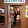 """Soul Food Cafe"" sign over kitchen door, with Jennifer Leichter"